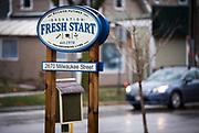 Cars pass by Operation Fresh Start on Milwaukee Street in Madison, WI on Thursday, April 11, 2019.
