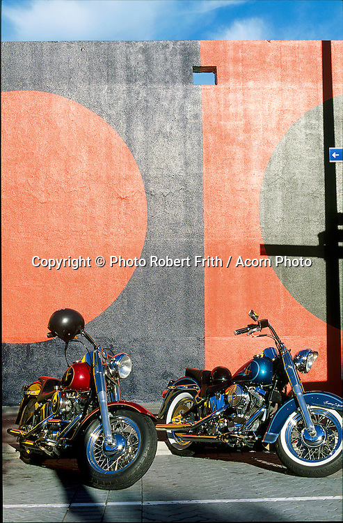 Harley Davidsons parked by a wall mural by Trevor Vickers<br /> note, the wall has subsequently been demolished