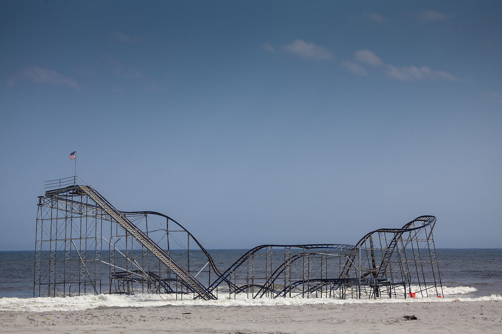 Devastation from Hurricane Sandy remains heavy into spring of 2013 in Seaside Heights, NJ.  The Roller coaster remains partially submerged in the Atlantic Ocean.  Jim Anness