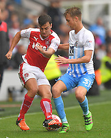 Fleetwood Town's Michael Duckworth battles with Coventry City's Ben Stevenson<br /> <br /> Photographer Dave Howarth/CameraSport<br /> <br /> The EFL Sky Bet League One - Fleetwood Town v Coventry Town - Saturday 3 September 2016 - Highbury Stadium - Fleetwood<br /> <br /> World Copyright © 2016 CameraSport. All rights reserved. 43 Linden Ave. Countesthorpe. Leicester. England. LE8 5PG - Tel: +44 (0) 116 277 4147 - admin@camerasport.com - www.camerasport.com