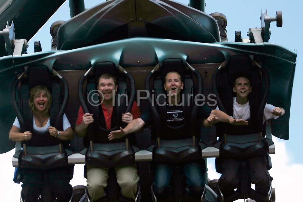 Visitors aboard the Oblivion ride at Alton Towers Amusement Park, Alton, UK