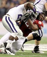 Arkansas defensive tackle DeQuinta Jones (92) tackles Kansas State running back Angelo Pease (29) during the first half of the Cotton Bowl Friday, Jan. 6, 2012, in Arlington, Texas.