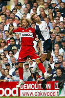 Photo: Chris Ratcliffe, Digitalsport<br /> Tottenham Hotspur v Middlesbrough. The Barclays Premiership. 20/08/2005.<br /> Gaizka Mendieta of Boro goes up for an aerial ball with Erik Edman of Spurs<br /> Norway only
