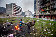 Children playing beside a fire in between highrise buildings at Lunik IX housing complex which is populated with almost 100% Roma inhabitants and located in the western-central part of the city of Kosice located in eastern Slovakia. The living conditions in Lunik IX are partly very bad and many people do not have electricity, water or gas. Some of the buildings are completely devasted. Lunik IX has officially 6542 registered (12/2015) inhabitants and almost all of them are of Roma ethnicity.