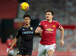 MANCHESTER, ENGLAND - Friday, January 1, 2020: Manchester United's captain Harry Maguire (R) and Aston Villa's Ollie Watkins during the New Year's Day FA Premier League match between Manchester United FC and Aston Villa FC at Old Trafford. The game was played behind closed doors due to the UK government putting Greater Manchester in Tier 4: Stay at Home during the Coronavirus COVID-19 Pandemic. (Pic by David Rawcliffe/Propaganda)