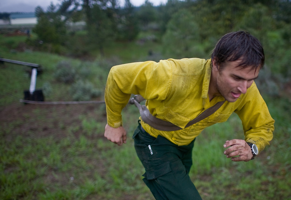 Nick Hasty runs up the final hill of an obstacle course as part of his training at the McCall smokejumper base in McCall, ID.