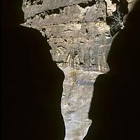 JORDAN. A traveler hikes in the Siq canyon leading to Petra.