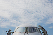 The nose and cockpit windshield of a Mitsubishi CRJ regional jet at the Farnborough Airshow, on 16th July 2018, in Farnborough, England.