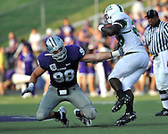 MANHATTAN, KS - AUGUST 30:  MANHATTAN, KS - August 30:  Defensive end Ian Campbell #98 of the Kansas State Wildcats reaches out to make a tackle on running back Cam Montgomery #26 of the North Texas Mean Green in the second quarter on August 30, 2008 at Bill Snyder Family Stadium in Manhattan, Kansas.  (Photo by Peter G. Aiken/Getty Images)