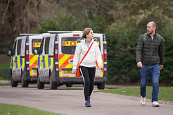 © Licensed to London News Pictures.20/02/2021. London, UK. Police vehicles are seen patrolling Hyde Park in central London while members of the public walking or exercising. The weather forecasts predict it will be the warmest weekend since November. The weather forecasts predict that it will be the warmest weekend since November.  Photo credit: Marcin Nowak/LNP