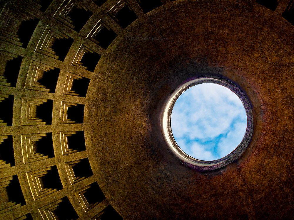 Pantheon; detail of oculus and dome interior coffered ceiling seen from below.  Blue sky and clouds visible through the open oculus.