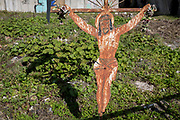 A sheet metal Jesus crucifix (a popular local copy from an historical Rutherian church) outside an abandoned industrial building on the outskirts of Jaworki, on 20th September 2019, <br /> near Szczawnica, Malopolska, Poland. The village of a thriving Rutherian community was once in nearby Biala Woda where over 100 farms were located - the remains of which are still seen. A wooden cross with a figure of Christ cut from sheet metal survived the culture.Similar crosses and chapels can be found in the colloquial language of White Water  in the Romanian, Ukrainian or Eastern Slovakia Carpathians.