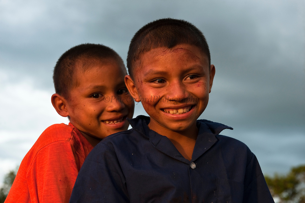 Amerindian Children covered in cow blood after slaughtering cow.<br /> Katoka Amerindian Village<br /> Rupununi<br /> GUYANA<br /> South America