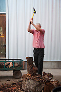 Ned Ludd, a restaurant in NE Portland, where nearly every dish is cooked in the restaurant's wood burning oven. Waiter Matthew Wesley Smith chops wood in front of the restaurant for the brick oven before dinner service.