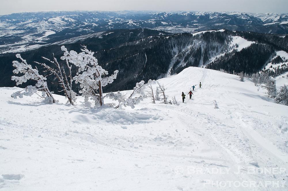 Skiers hiking Mount Glory on Teton Pass