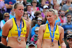 13.07.2014, Beach Village, Gstaad, SUI, FIVB Beach Volleyball Grand Slam Gstaad, im Bild Enttaeuschte Britta Buethe und Karla Borger (GER) // during the FIVB Beach Volleyball Grand Slam Gstaad at the Beach Village in Gstaad, Switzerland on 2014/07/13. EXPA Pictures © 2014, PhotoCredit: EXPA/ Freshfocus/ Claude Diderich<br /> <br /> *****ATTENTION - for AUT, SLO, CRO, SRB, BIH, MAZ only*****