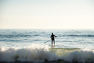 Stand Up Paddle Boarder heading out over wave at Terramar Surf Beach in Carlsbad, CA<br /> <br /> THIS IMAGE ALSO AVAILABLE AS SIGNED, LIMITED EDITION PRINT. SERIES LIMITED TO 10. <br /> <br /> EMAIL RR@ROBERTRANDALL.COM FOR PRICING