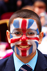 LONDON, UK  29/04/2011. The Royal Wedding of HRH Prince William to Kate Middleton. Prime minister David Cameron and his wife Samatha host a Royal Wedding Street Party outside Number 10 Downing Street. Young and old guests from a range of charities enjoyed cakes, party games including tug of war, catching water bombs and face painting (Mahdi Hadi from Pimlico Academy pictured here with his face painted with a union jack).  Photo credit should read CLIFF HIDE/LNP. Please see special instructions. © under license to London News Pictures