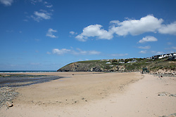 """© Licensed to London News Pictures. 11/05/2020. Newquay, UK. Mawgan Porth beach on the North coast of Cornwall is nearly empty, the day after British Prime Minister Boris Johnson announced a 'road map' to lift lockdown restrictions due to Covid-19, (Coronavirus). A rise in """"staycations"""" - the concept of holidaying in your home country rather than travelling abroad - is expected, with many visitors planning to visit Cornwall. However, an ongoing campaign titled """"#ComeBackLater"""" is trying to persuade tourists not to visit the county until it is safe to do so. Photo credit : Tom Nicholson/LNP"""