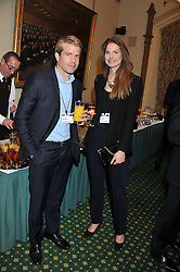 NICK HOUSE and LOUISE KUGELBERG at a reception for The Mirela Fund in partnership with Hope and Homes for Children hosted by Natalie Pinkham in The Churchill Room, House of Commons, London on 30th April 2013.