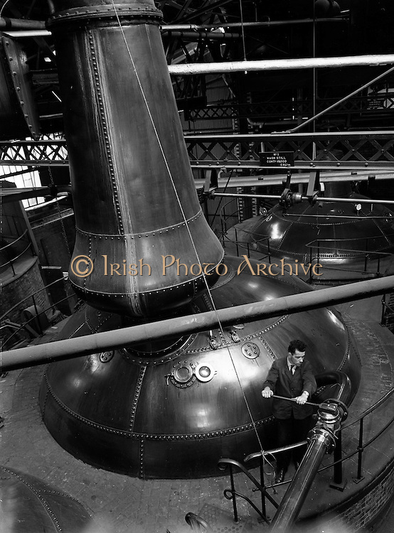 16-17/12/1959<br /> 12/16-17/ 1959<br /> 16-17 December 1959<br /> Distillery at Powers Dublin. At  John Power charging a still of Powers with 19,000 gallons of wash. This was the largest whiskey still in the world.