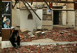 A Palestinian mourns the news of Yasser Arafat's death in front of the destroyed area of his presidential compound, Gaza, Palestinian Territories, Nov. 11, 2004. Arafat died in a Paris hospital at the age of 75.