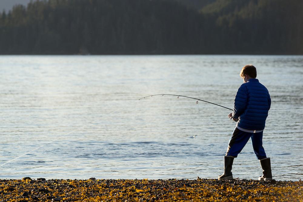 Boy with fish on the line in Starrigavan Bay, near Sitka, Alaska.