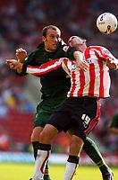 Photo: Alan Crowhurst.<br /> Southampton v Norwich City. Coca Cola Championship.<br /> 20/08/2005. Dean Ashton goes in hard on Danny Higginbotham of Saints.