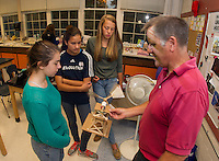 Becca Camire, Sana Syed and Katie Gagnon test out their windmill with Mr. White during their engineering project on Wednesday morning.  (Karen Bobotas/for the Laconia Daily Sun)