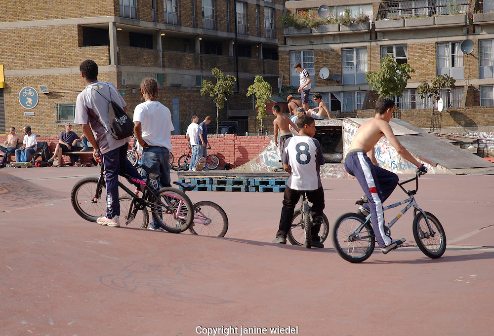 Youths on BMX cycles  at urban Skate park in Brixton South London.
