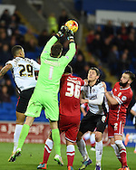 David Marshall, the Cardiff city goalkeeper punches clear from a Rotherham corner as Jason Clarke-Harris (29) and Alex Revell (9) look for a goal.  Skybet football league championship match, Cardiff city v Rotherham Utd at the Cardiff city stadium in Cardiff, South Wales on Saturday 6th December 2014<br /> pic by Andrew Orchard, Andrew Orchard sports photography.