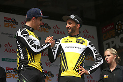 Overall Race Leaders Henrique Avancini and Manuel Fumic of Cannondale Factory Racing XC celebrate on the podium during stage 1 of the 2017 Absa Cape Epic Mountain Bike stage race held from Hermanus High School in Hermanus, South Africa on the 20th March 2017<br /> <br /> Photo by Shaun Roy/Cape Epic/SPORTZPICS<br /> <br /> PLEASE ENSURE THE APPROPRIATE CREDIT IS GIVEN TO THE PHOTOGRAPHER AND SPORTZPICS ALONG WITH THE ABSA CAPE EPIC<br /> <br /> ace2016