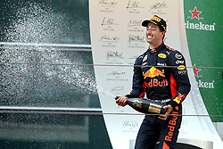 SHANGHAI, April 15, 2018  Red Bull's driver Daniel Ricciardo of Australia sprays champagne to celebrate on the podium after winning the Formula One Chinese Grand Prix in Shanghai, east China, April 15, 2018. Daniel Ricciardo claimed the title of the event in 1 hour, 35 minutes and 36.380 seconds.  dx) (Credit Image: © Fan Jun/Xinhua via ZUMA Wire)