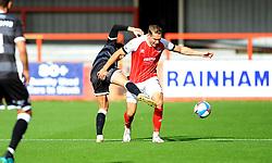 Tom Nichols of Crawley Town tackles Chris Hussey of Cheltenham Town- Mandatory by-line: Nizaam Jones/JMP - 10/10/2020 - FOOTBALL - Jonny-Rocks Stadium - Cheltenham, England - Cheltenham Town v Crawley Town - Sky Bet League Two