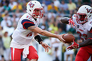 WACO, TX - SEPTEMBER 2:  Stephen Calvert #12 of the Liberty Flames hands the ball off to Frankie Hickson #23 against the Baylor Bears during a football game at McLane Stadium on September 2, 2017 in Waco, Texas.  (Photo by Cooper Neill/Getty Images) *** Local Caption *** Stephen Calvert; Frankie Hickson