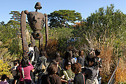 Visitors to the museum by a robot figure on the roof of the museum. The character is from Miyazaki's film  Laputa (Castle in the Sky). The Ghibli Museum in Mitaka, western Tokyo opened in 2001. It was designed by animator Miyazaki Hayao and receives around 650,500 visitors each year.