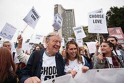 © Licensed to London News Pictures. 17/09/2016. London, UK. Lord ALFRED DUBS (L), who was brought to Britain on the Kindertransport during the Second World War, joins thousands as they march through central London to call on the government to welcome refugees to the UK. Photo credit: Rob Pinney/LNP