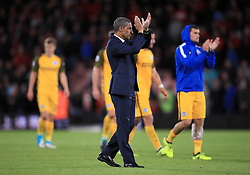 Brighton & Hove Albion manager Chris Hughton applauds the fans after the final whistle of the Premier League match at the Vitality Stadium, Bournemouth.