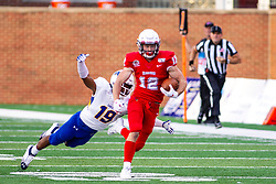 NORMAL, IL - September 07: Jelani Ray Garvin lunges at the legs of Redbirds runner Taylor Grimes during a college football game between the ISU (Illinois State University) Redbirds and the Morehead State Eagles on September 07 2019 at Hancock Stadium in Normal, IL. (Photo by Alan Look)