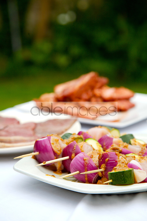 Close up of barbeque platter of food on garden table