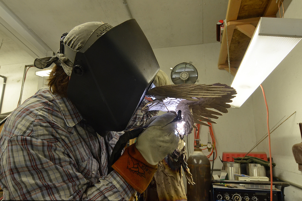 Welder working on a bronze sculpture at the foundry at Hot Lake Springs, Oregon.