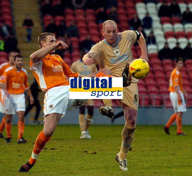Photo: Jed Wee.<br />Blackpool FC v Bristol City. Coca Cola League 1. 21/01/2006.<br />Blackpool's Peter Clarke (L) stretches out a leg to deny Bristol's Steven Brooker.