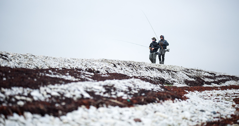 23 November 2016, Fårö, Gotland, Sweden: Robert Hansson from Fish Your Dream (right) and Max Svensson (left), walking along the coastline of the island of Fårö, during a day of flyfishing for seatrout.