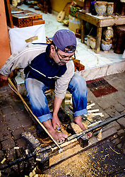 A man carving wooden objects in a traditional manner in the medina in Marrakech, Morocco, North Africa<br /> <br /> (c) Andrew Wilson | Edinburgh Elite media