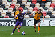 Tranmere Rover's Kaiyne Woolery under pressure from Newport County's Matthew Dolan (8) during the EFL Sky Bet League 2 match between Newport County and Tranmere Rovers at Rodney Parade, Newport, Wales on 17 October 2020.