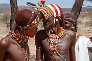 Young men of the Samburu tribe. The Samburu are a Nilotic people of north-central Kenya. Samburu are semi-nomadic pastoralists who herd mainly cattle but also keep sheep, goats and camels.