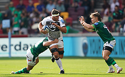 Sale Sharks' Jono Ross (centre) is tackled by London Irish's Matthew Rogerson (left) and Paddy Jackson during the Gallagher Premiership match at the Brentford Community Stadium, London. Picture date: Sunday September 26, 2021.