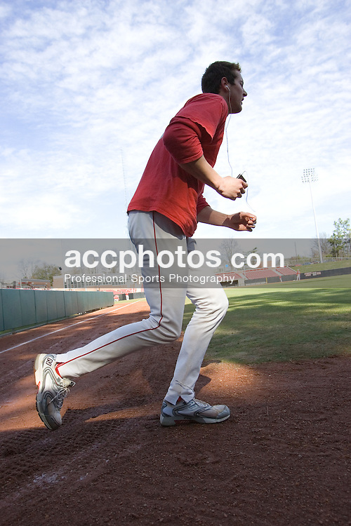 """03 February 2007: North Carolina State Wolfpack RHP Andrew Brackman (40) runs """"polls"""" which requires players to run from one light pole to the other and the end of the field after finishing a scrimmage at Doak Field in Raleigh, NC."""