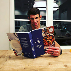 "Michael Phelps releases a photo on Instagram with the following caption: ""Hmm what should we try during the holidays?? I\u2019m checking some new recipes out.... and so is boomer!! We\u2019re gonna make a special meal for mommy real soon!!!! @blueapron #homefortheholidays #thefamilythatcookstogether"". Photo Credit: Instagram *** No USA Distribution *** For Editorial Use Only *** Not to be Published in Books or Photo Books ***  Please note: Fees charged by the agency are for the agency's services only, and do not, nor are they intended to, convey to the user any ownership of Copyright or License in the material. The agency does not claim any ownership including but not limited to Copyright or License in the attached material. By publishing this material you expressly agree to indemnify and to hold the agency and its directors, shareholders and employees harmless from any loss, claims, damages, demands, expenses (including legal fees), or any causes of action or allegation against the agency arising out of or connected in any way with publication of the material."