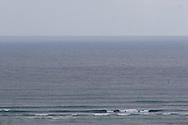 Waves of an ocean roll toward the viewer.